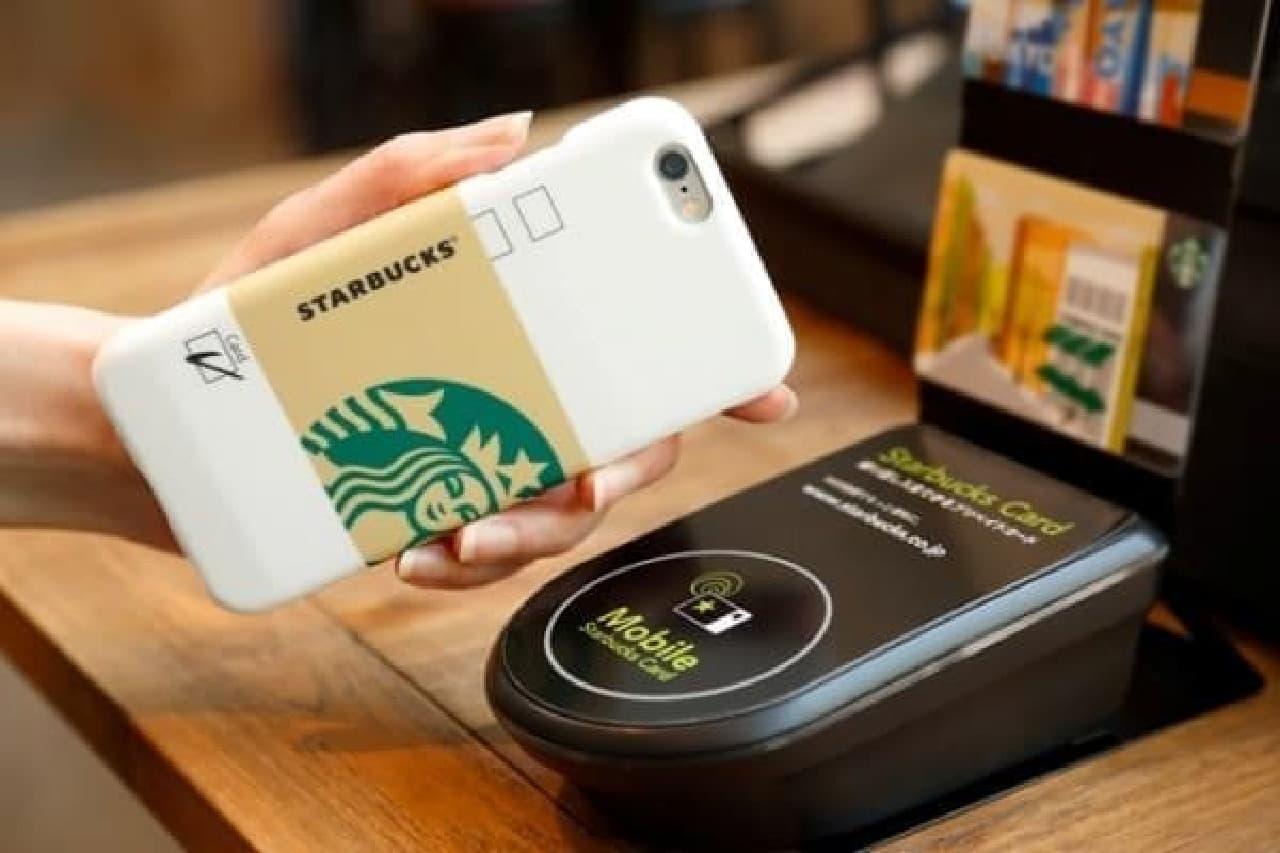 支払いは iPhone を かざすだけ!(出典:スターバックス公式サイト)