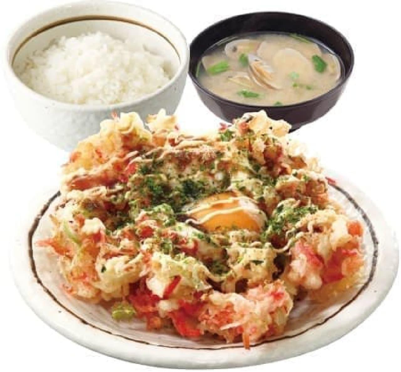 お好み焼きの天ぷらをおかずに、白飯を食べる