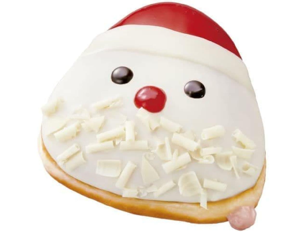 「ストロベリー チーズ サンタ」は、ホワイトチョコをベースに、ストロベリーナパージュとビターチョコで描いたサンタのドーナツ
