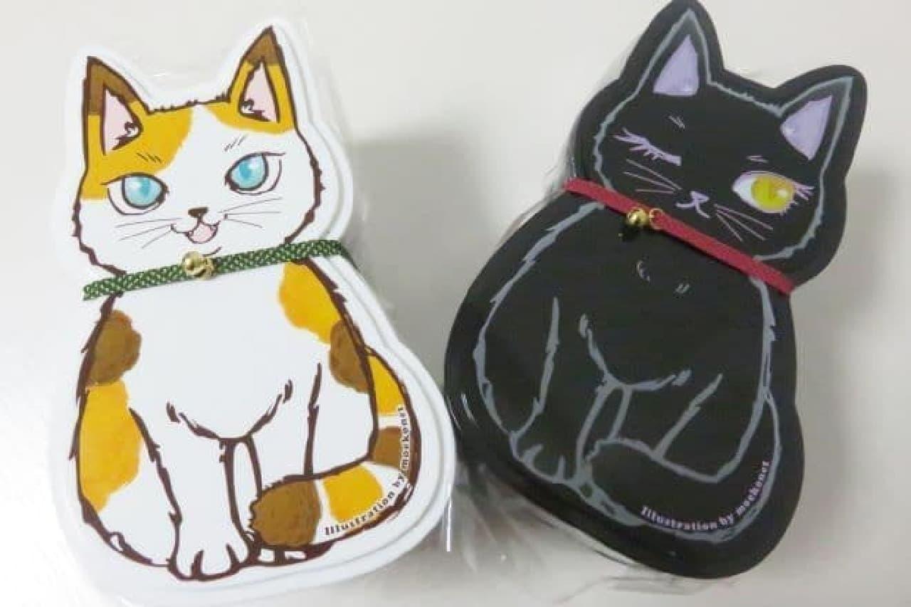、猫型の容器にご飯とおかずが詰められたお弁当