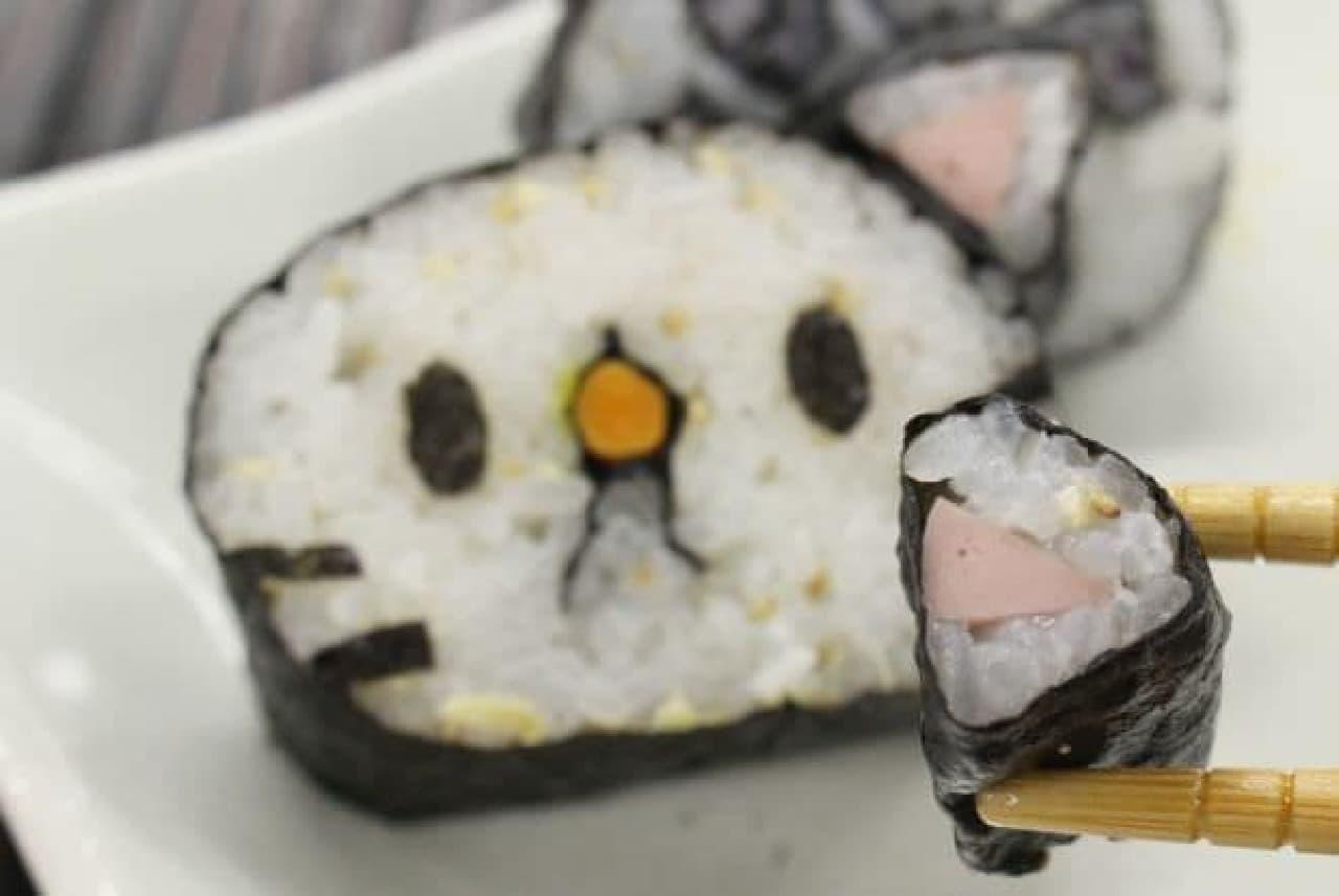 「若廣の肉球助六セット」は、猫の顔や肉球を模した太巻きが入った助六寿司