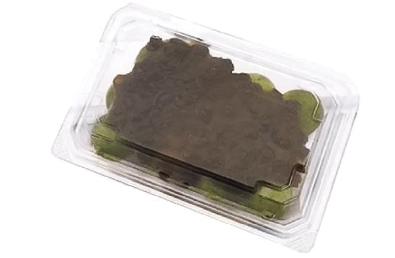 草だんご つぶあん 12個入はやわらかなよもぎの草団子12個の上に、つぶあんがかけられた和菓子