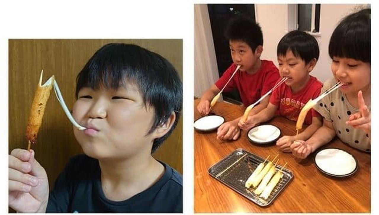 串カツ田中オンラインショップ「のび~るチーズ串セット」を食べている子供
